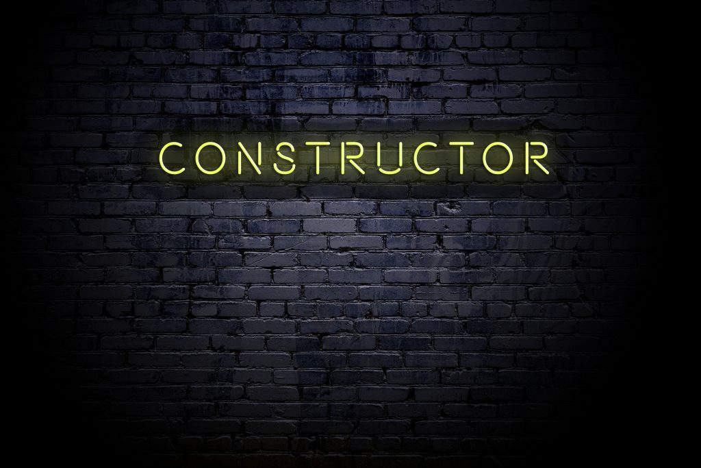 Highlighted brick wall with neon inscription constructor
