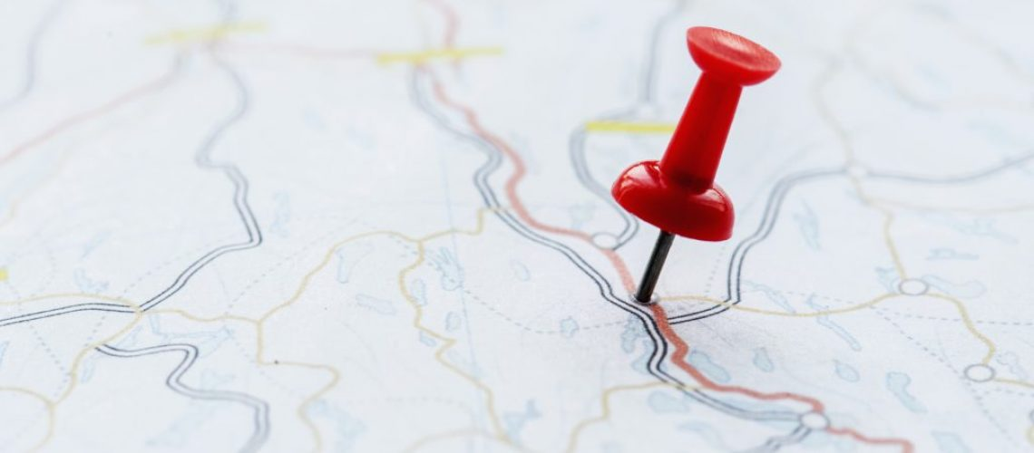 Closeup of pushpin showing the location on the map