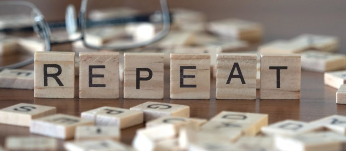 repeat the word or concept represented by wooden letter tiles