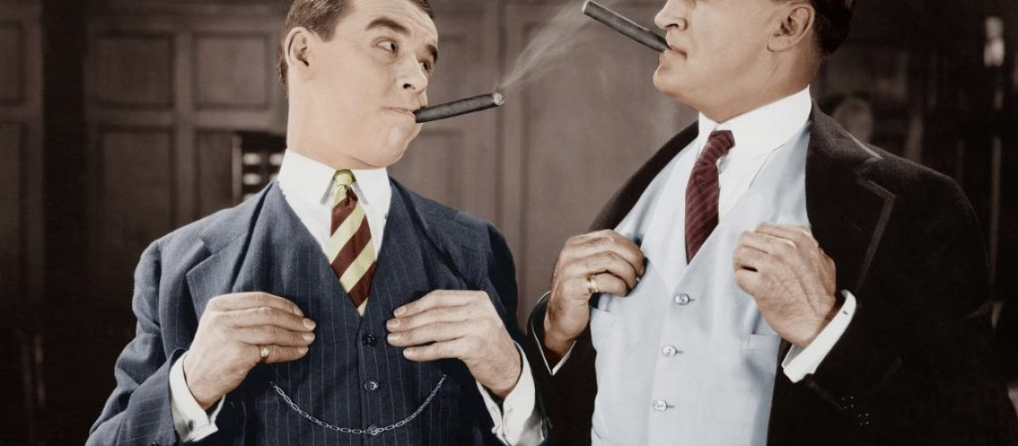 Two men smoking cigars  (All persons depicted are not longer living and no estate exists. Supplier warranties that there will be no model release issues.)