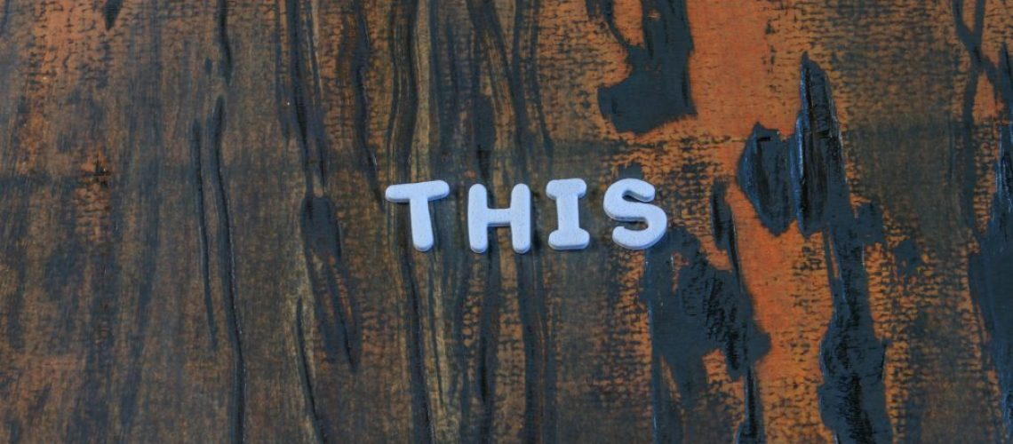 this written in white lettering on dark weathered wood